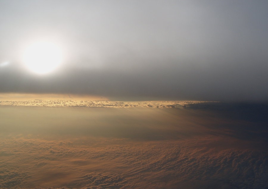 The sun and clouds in the afternoon from cruising altitude